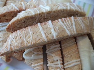 Orange-Pecan Biscotti drizzled with white chocolate