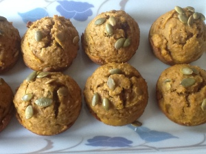 Toasted pumpkin seeds atop Pumpkin Muffins
