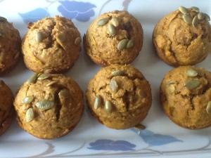 Toasted pumpkin seeds atop Pumpkin Muffins